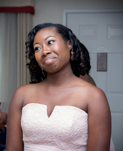 A brides maid reacts to seeing a bride in her wedding dress before a wedding at all saints chapel in raleigh, nc