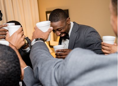 A groom makes a toast before a wedding at the Hilton Garden Inn in Raleigh, NC