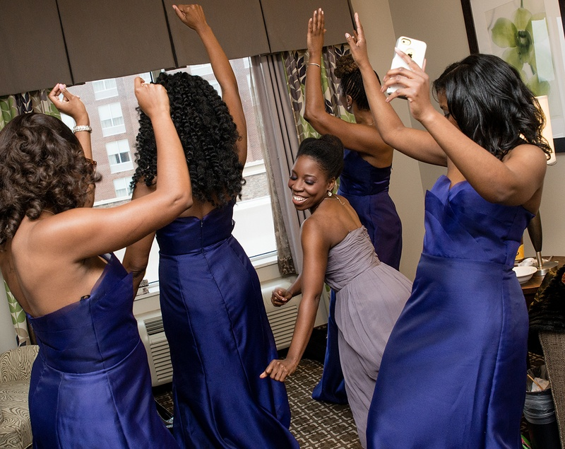 Brides maids dance before a wedding at the Hilton Garden Inn in Raleigh, NC