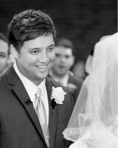 A groom says his vows at a wedding at St Thomas Aquinas Church in Charlotte, NC