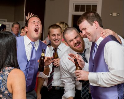 Groomsmen enjoy a reception at Asbury Park Grove in Charlotte, NC