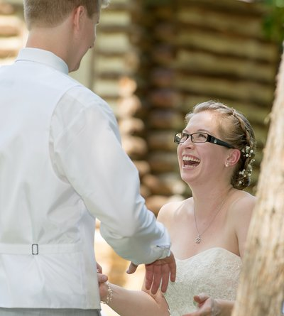 A bride laughs at a wedding ceremony at Spruce Pine Lodge in Bahama, NC