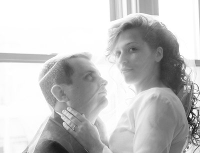 A bride and groom pose before a wedding in sanford, nc