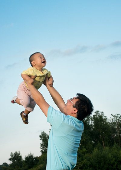 A father lifts his son at Lake Hogan Farms in Chapel Hill, NC