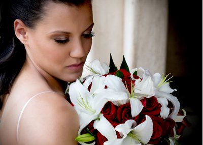 A bride with a bouquet of Asian lilies at a wedding in Raleigh, NC
