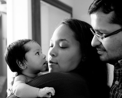 A newborn baby with his mother and father in Raleigh, NC