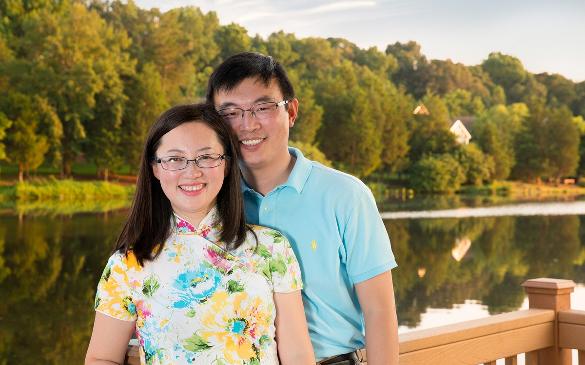 A husband and wife pose at sunset in chapel hill, nc