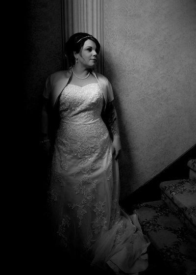 A bride poses before a wedding at the Preston Woodall House Bed and Breakfast in Benson, NC