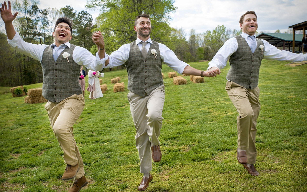 A groom and his groomsmen have fun before a wedding at the cabin at hillside farms in henderson, nc