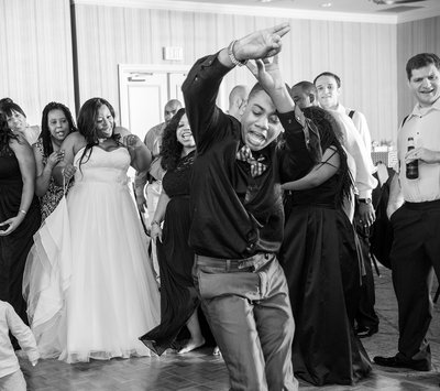 a teen dances at a reception at the doubletree suites in durham, nc