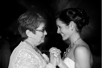 A bride and her mother have a special moment before a wedding at the cabin at hillside farms in henderson, NC