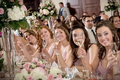 A bridal party toasts the bride and groom at a wedding in Raleigh, NC