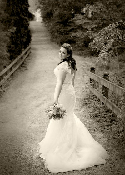 A bride walking at UNC Botanical Gardens in Charlotte, NC