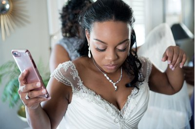 A bride dresses before a wedding in Raleigh, NC