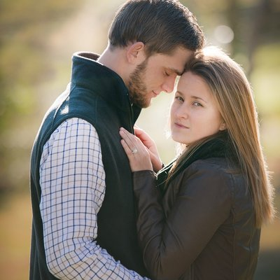 A couple pose at an engagement shoot in Chapel Hill, NC