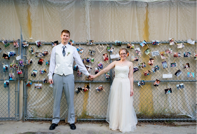 A creative photo wall for a wedding reception at the Spruce Pine Lodge