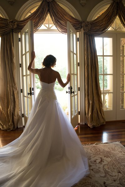 Bride opening french doors