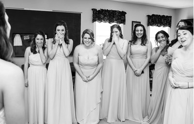 Bridesmaids are moved by a first look of the bride in Raleigh, NC