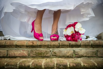 Hot pink wedding shoes with matching bouquet
