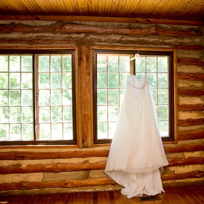 Wedding Dress Hanging In The Window At Spruce Pine Lodge, Bahama, Nc