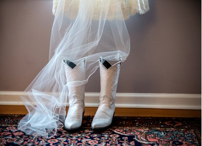 White cowboy boots and a veil at a wedding in Raleigh, NC
