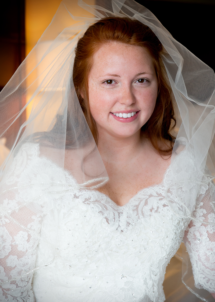 A bride poses before a wedding at The Stockroom at 230 in Raleigh, NC