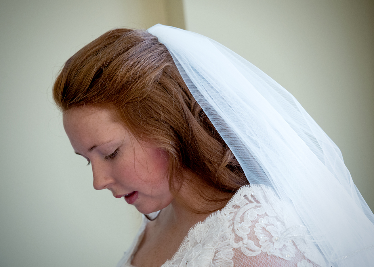 A bride poses before a wedding at The Stockroom at 230 in Raleigh2, NC