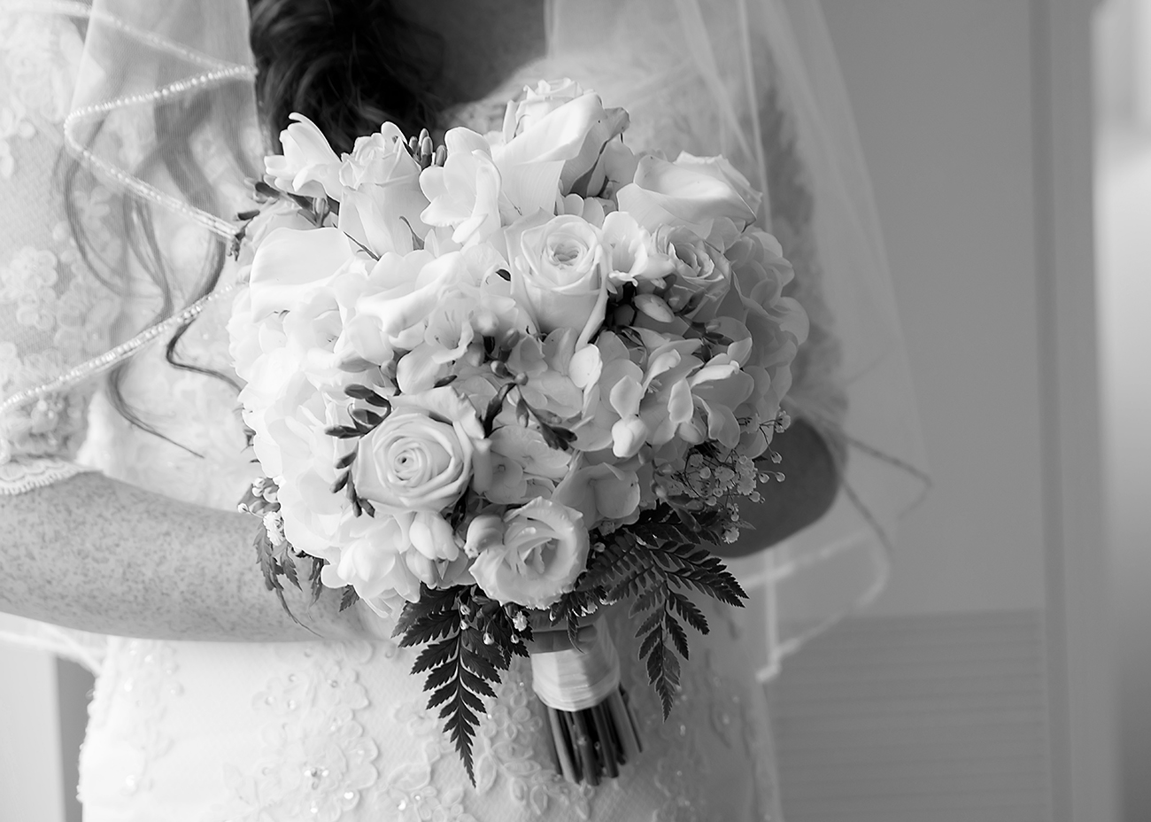 A bride's bouquet of roses at a wedding at the Downtown Mariott in Raleigh, NC