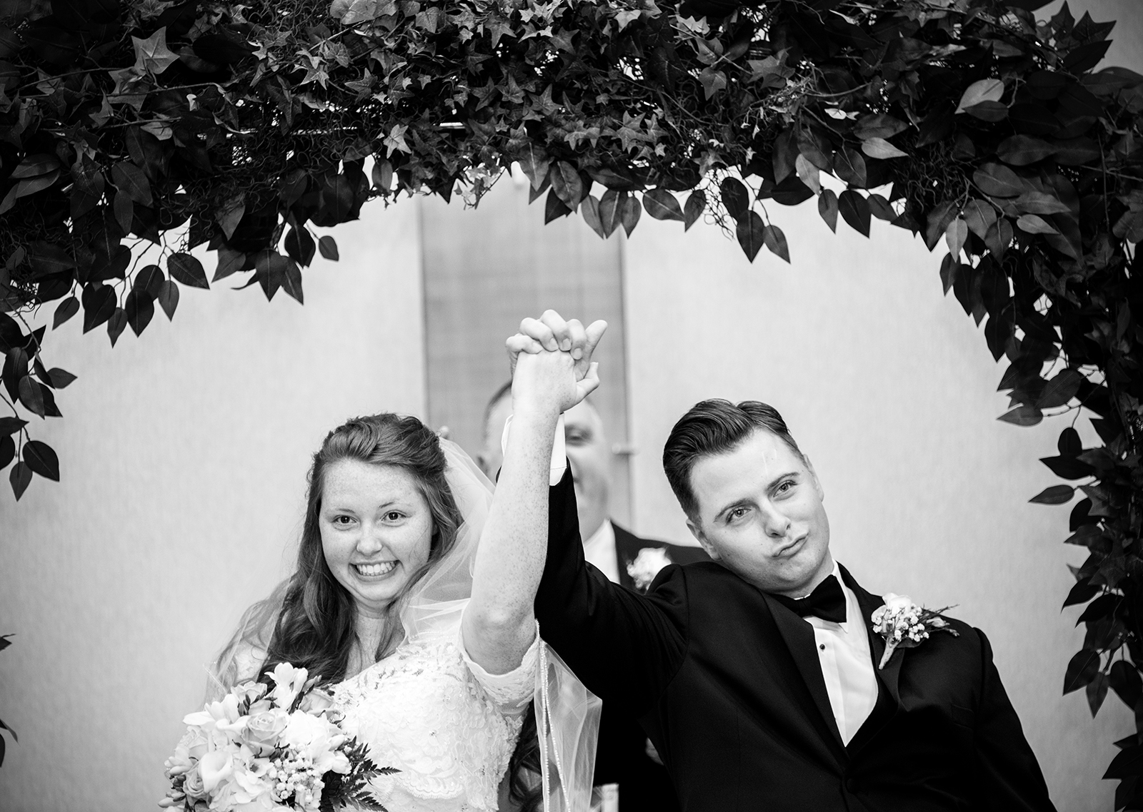 An elated bride and groom at a wedding at the downtown Marriott in Raleigh, NC