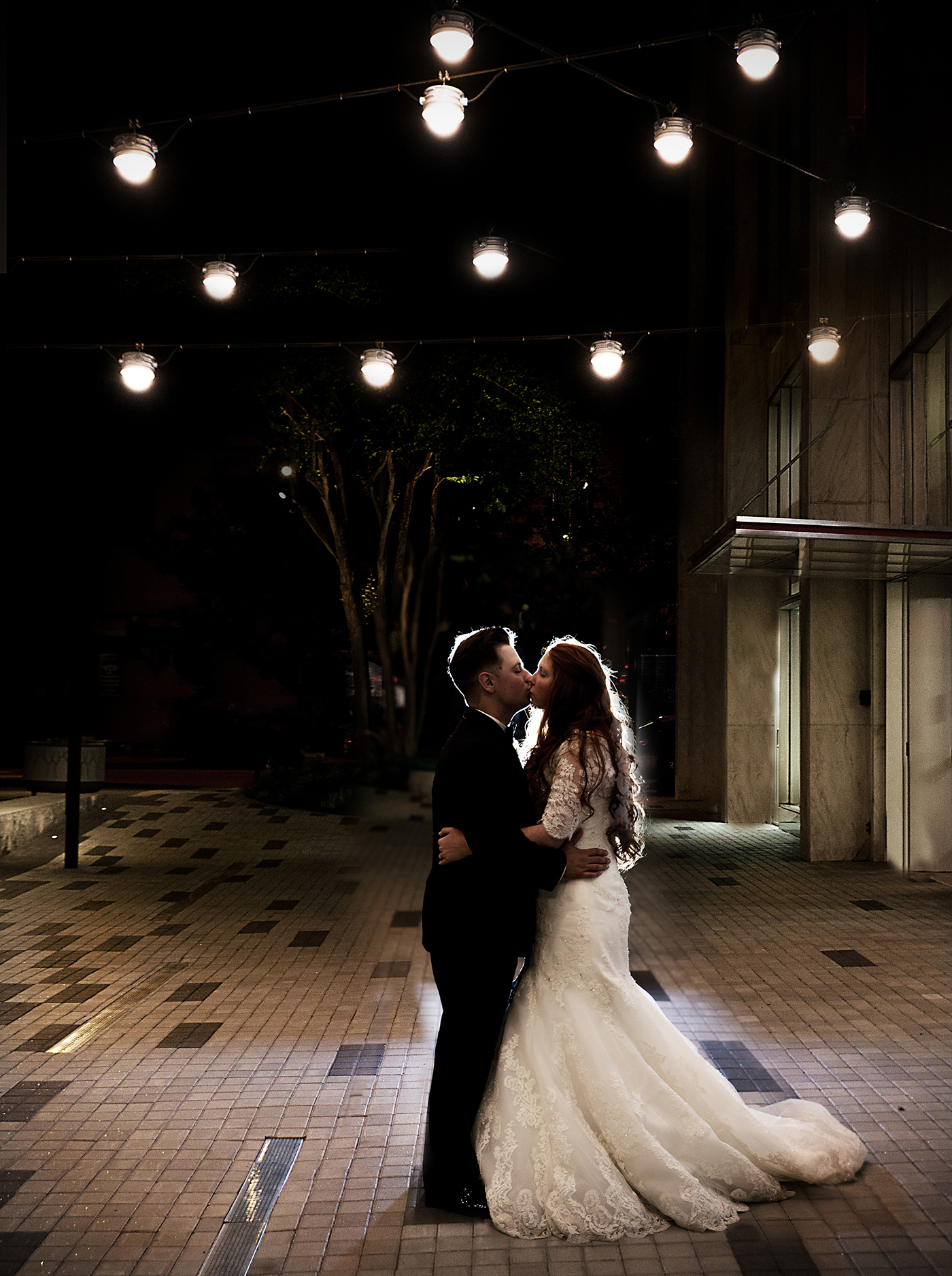 A bride and groom kiss at a wedding at the Stockroom in downtown Raleigh, NC