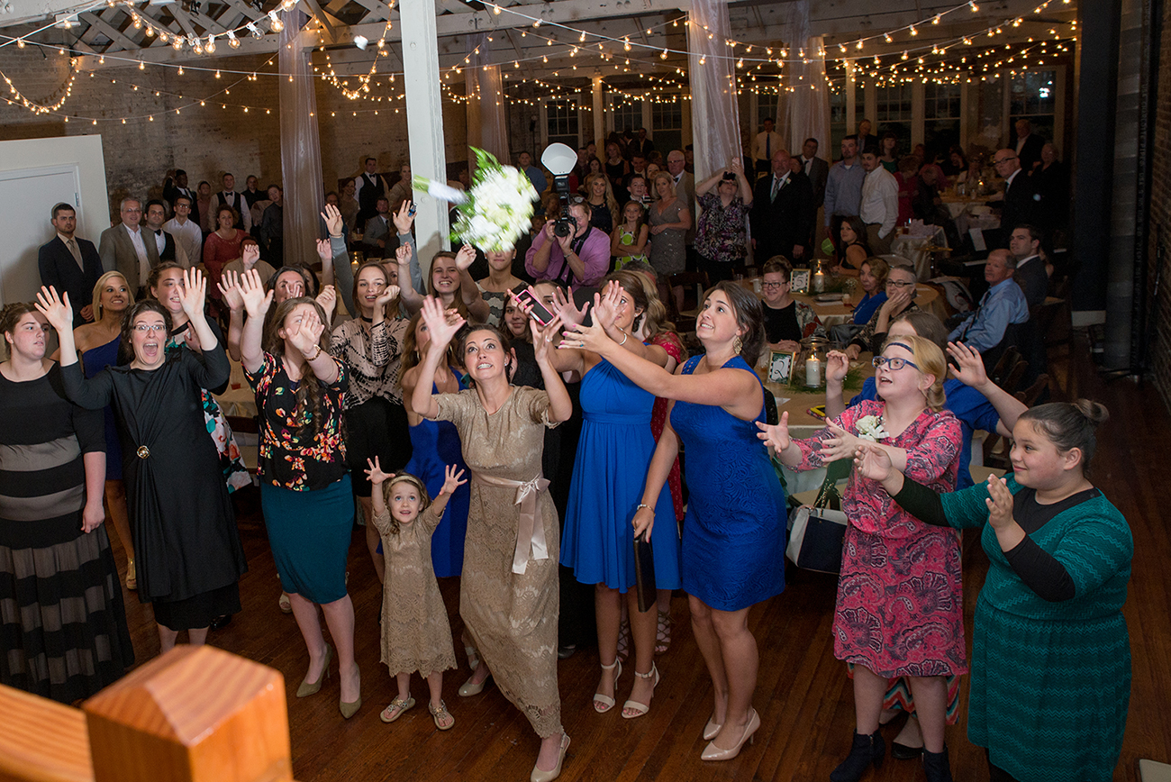 Catching the bouquet at a wedding at the stockroom 230 in raleigh, nc
